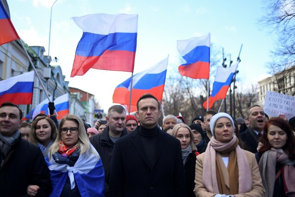 The Russian opposition leader Aleksei A. Navalny, center, at a march in Moscow last year.