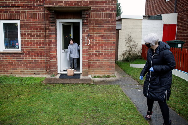 Delivering food parcels to a family in Milton Keynes, Britain, last week.