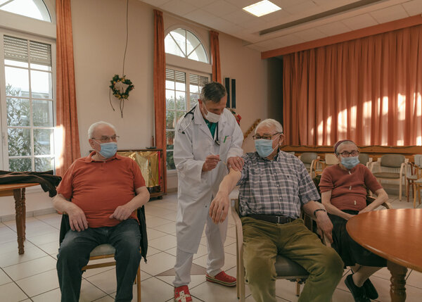 Nursing home residents in Reims, France, received the Covid-19 vaccine last week. The World Health Organization is concerned about the spread of a new variant throughout Europe.