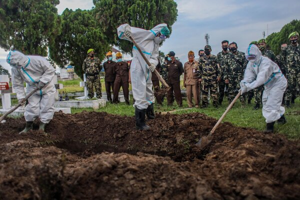 A funeral in Indonesia on Monday  for someone who died from the coronavirus.