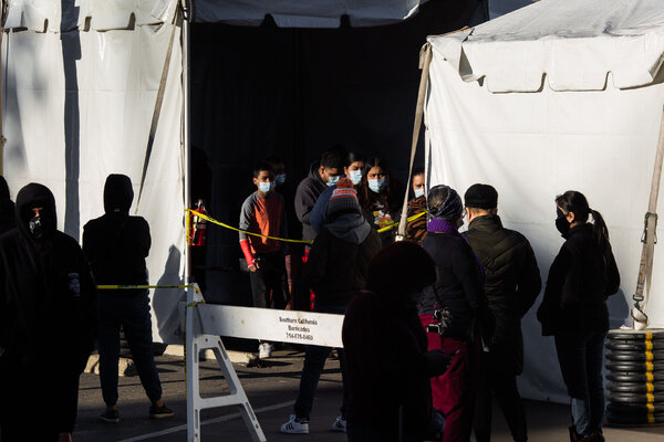 People waiting in line at a coronavirus testing site in Los Angeles this month.