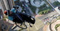 Effort to Climb Skyscraper in Wheelchair Captivates Hong Kong
