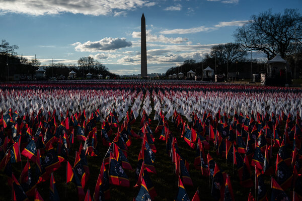 A field of flags from U.S. states planted on the National Mall on Monday to represent the thousands of Americans who would normally attend the inauguration.