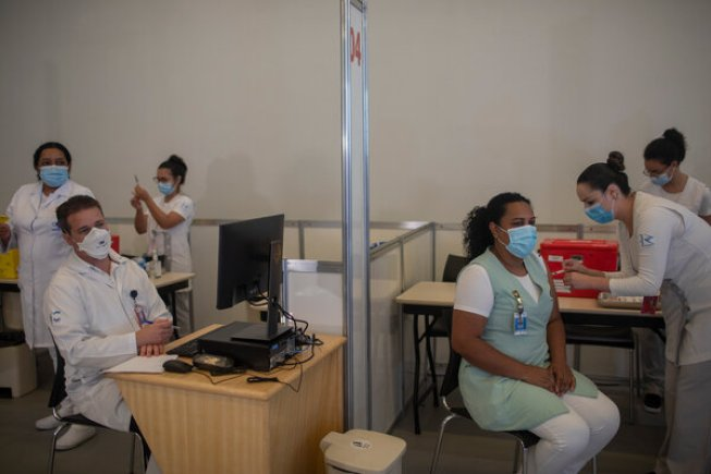 Vaccinations of nurses, doctors and health professionals in São Paulo, Brazil, this week.