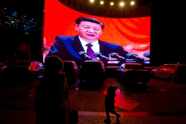 China's leader, Xi Jinping, on a screen in Kashgar, in the Xinjiang region, in 2018.