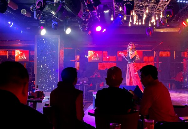 A singer performing in a nightclub in Dubai in November. Dubai has been hesitant to shut down its entertainment sector but is finally enacting restrictions amid a rise in coronavirus cases.