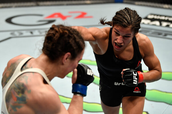 Julianna Pena beat Sara McMann in the third round with a rear naked choke.