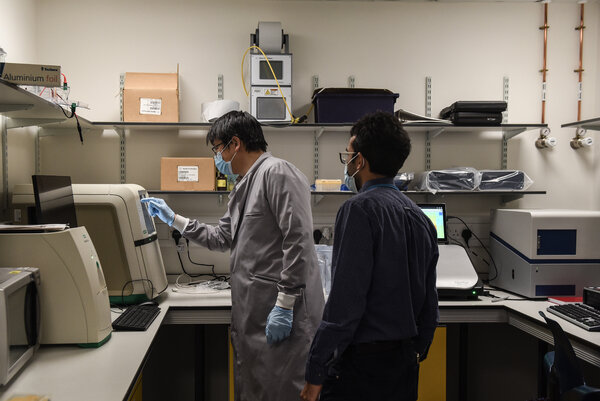 Scientists at the Jeffrey Cheah Biomedical Centre in Cambridge, England, where researchers are tracking coronavirus variants and trying to determine how well current vaccines can combat them.