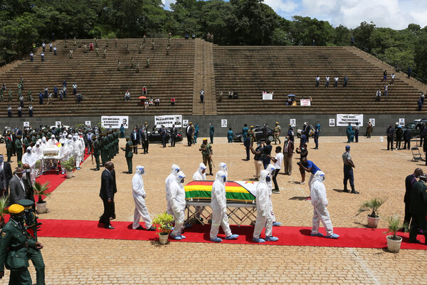 Pallbearers carried the coffin of Ellen Gwaradzimba, the minister of provincial affairs for the Manicaland Province, who died of Covid-19, at the Heroes Acre in Harare, Zimbabwe, on Thursday.