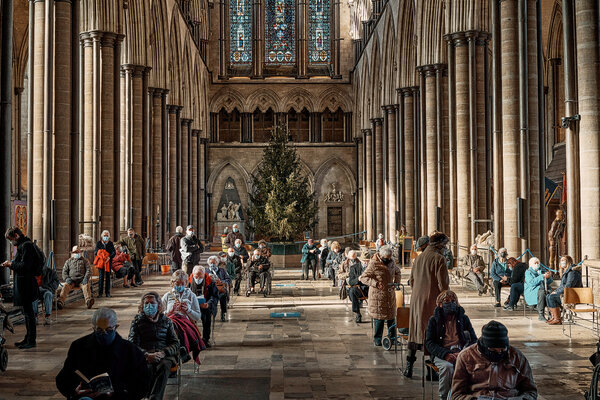 Salisbury Cathedral, which is being used as a vaccination site in Salisbury, England. Lockdowns across Britain are expected to be prolonged.