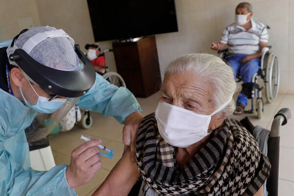 Francisca Alves Xavier, 102, receiving China's Sinovac vaccine in Brasília last week.