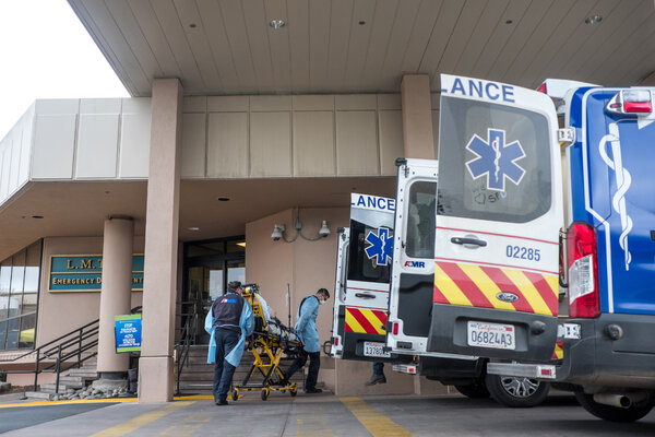 Medical personnel transporting a patient at Salinas Valley Memorial Healthcare System in Salinas, Calif., on Sunday.