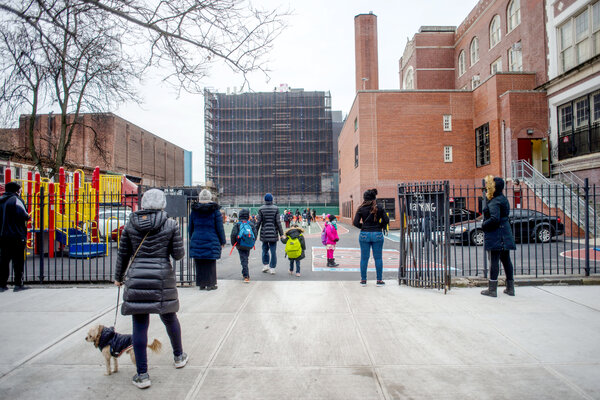 Students arriving for in-person learning at a public school in Brooklyn this month.
