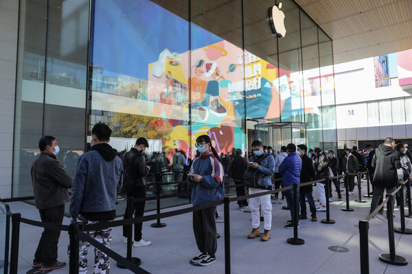 Customers line up for the iPhone 12 in Beijing. Apple had its most profitable quarter ever, driven by the new iPhone and sales in China.
