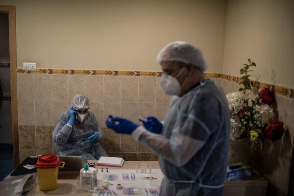 Nurses preparing vaccines at a nursing home in Spain last week.
