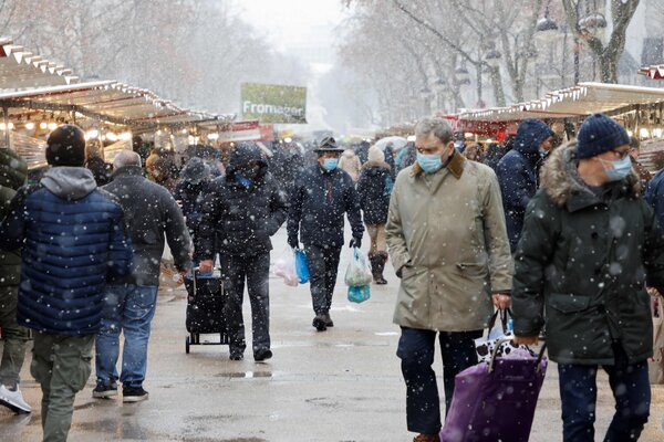 A market in Paris this month. The French economy shrank 8.3 percent overall in 2020, but performed better than expected in the October-December quarter.