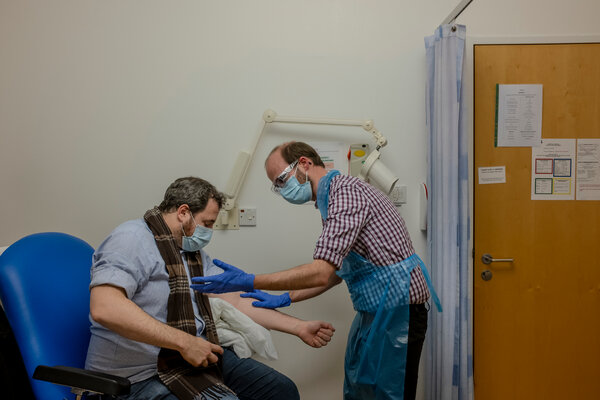 A volunteer in the Oxford-AstraZeneca vaccine trial getting a shot in Oxford, England, in November.