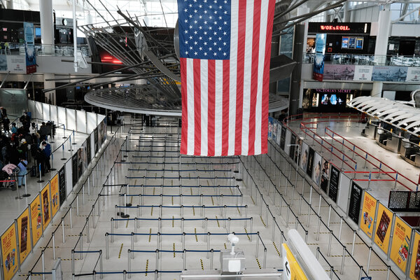 A nearly empty international terminal at John F. Kennedy Airport in New York on Monday.