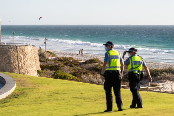 Police patrol Scarborough Beach near Perth, Australia, on Sunday after officials announced a lockdown for the region.