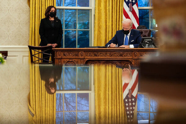 President Biden signing executive orders aimed at the immigration system on Tuesday.