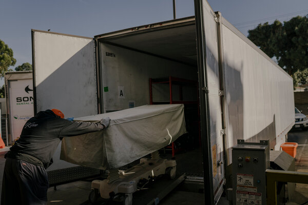 Mr. Flores's body was taken to a refrigerated trailer outside the hospital. The regular morgue was full.