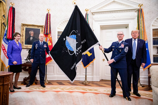 Military leaders present President Donald J. Trump with the official flag of the United States Space Force at the White House in May.