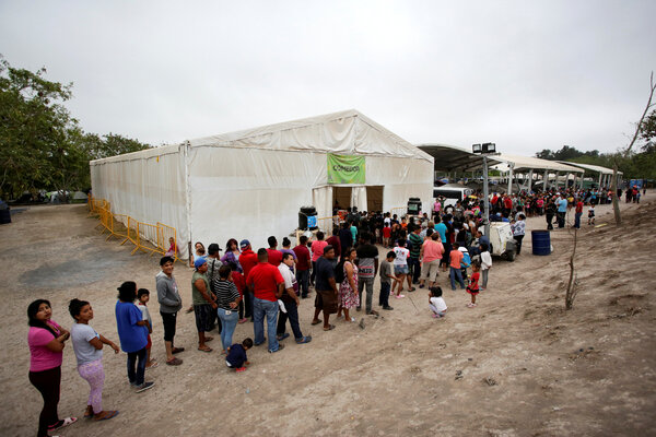 Migrants seeking asylum in the United States lined up for food in Matamoros, Mexico, last year. Some border camps have become increasingly crowded in recent weeks.