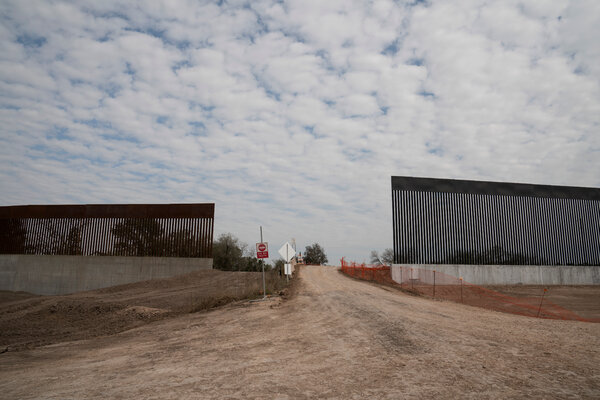 A gap in the wall for a road near Alamo would typically have a gate. The taller section on the right is part of the newer wall where former President Donald Trump visited in early January.