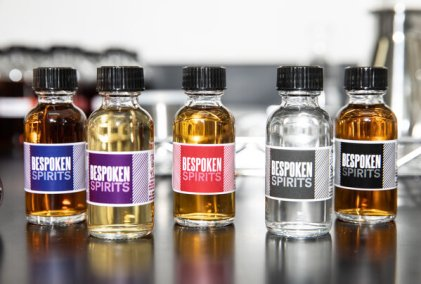 """Bespoken has several products on the market, including three kinds of whiskey and a dark rum. The clear bottle, second from right, is their """"source"""" spirit."""