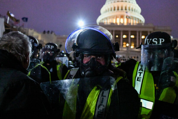 Police officers and National Guard members worked to disperse former President Donald Trump's supporters from the Capitol after rioters breached the building on Jan. 6.