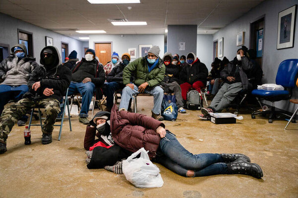 In Kansas City, Mo., where temperatures fell below zero, people tried to stay warm at the headquarters of Street Medicine Kansas City, a nonprofit organization that assists the homeless.