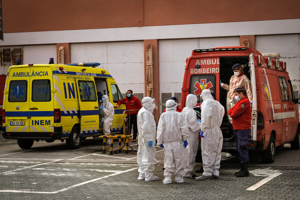 Medical workers outside Garcia de Orta Hospital near Lisbon this month. The European Center for Disease Prevention and Control is advising the E.U. to stay vigilant despite reduced case numbers.