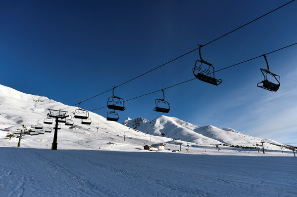 Closed ski lifts at a resort in Ponte di Legno. Italy announced on Sunday that it would delay a reopening planned for Monday until March.