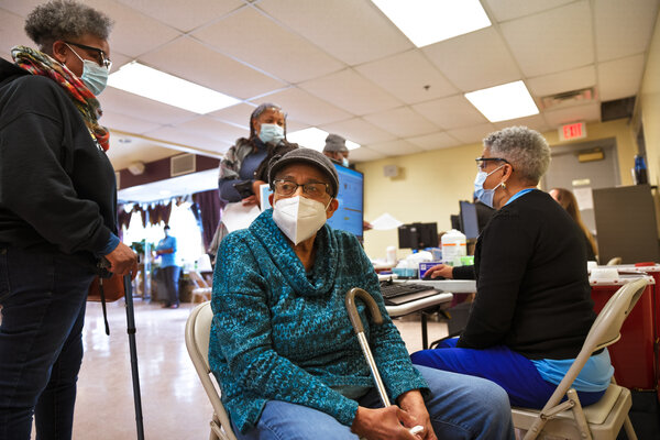A woman waits for her vaccination in Bates Memorial Baptist Church in Louisville, Ky., on Friday, the first day that Norton Healthcare offered shots in predominantly Black areas of the city.