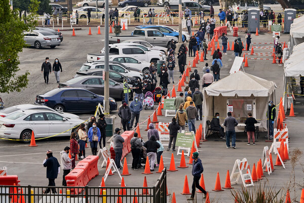 A line for coronavirus tests in Los Angeles. The life expectancy gap between Black and white Americans grew during the pandemic to six years, the largest figure since 1998.