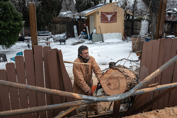 Gilberto Estevez cut up a tree in Austin, Texas, on Wednesday. More snow was expected in parts of the state on Thursday.