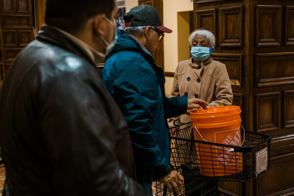 Residents in the lobby of the Granada Homes, a low-income apartment complex for the elderly in San Antonio, collected buckets of water to bring back to their bathrooms in order to flush their toilets.