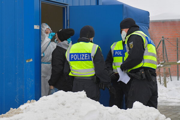 A traveler receiving a rapid test for the coronavirus at the Czech-German border.