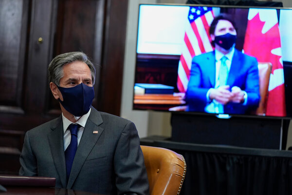 Secretary of State Antony J. Blinken listened as Prime Minister Justin Trudeau of Canada spoke during a virtual meeting with President Biden on Tuesday.
