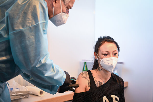 A nurse gets her first dose of the AstraZeneca coronavirus vaccine at the vaccination center in Rostock, Germany, this month. Many people are skipping appointments or refusing to sign up for the AstraZeneca shot, which they fear is less effective than the Pfizer-BioNTech vaccine.