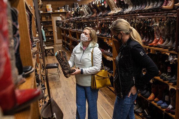 Tracy Davie, left, and Renee Thevenot, both wearing masks, shopping in Austin, Texas, in January.