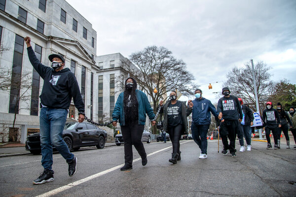 A protest of a bill that would restrict voting access outside the State Capitol in Atlanta on Monday.