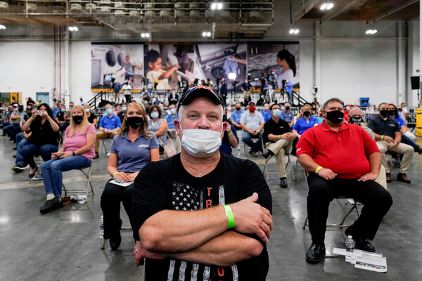 A worker in a Trump 2020 campaign shirt was front and center among others listening to President Donald J. Trump speak at a Whirlpool Corporation washing machine factory in Clyde, Ohio, in August.