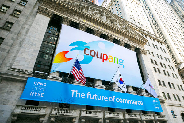 A banner for the South Korean retailer Coupang hung in front of the New York Stock Exchange on Thursday, the day the company's shares began trading.