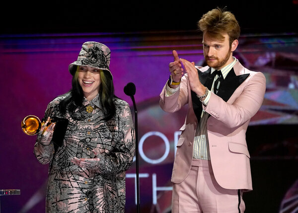 Billie Eilish, left, and Finneas, her brother, accept the award for record of the year.