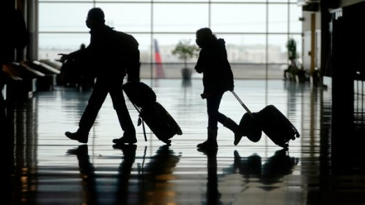 Travelers at the Salt Lake City International Airport on Tuesday. The nation's airports show increasing signs of life.