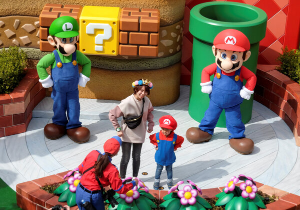Mario and Luigi characters with visitors.