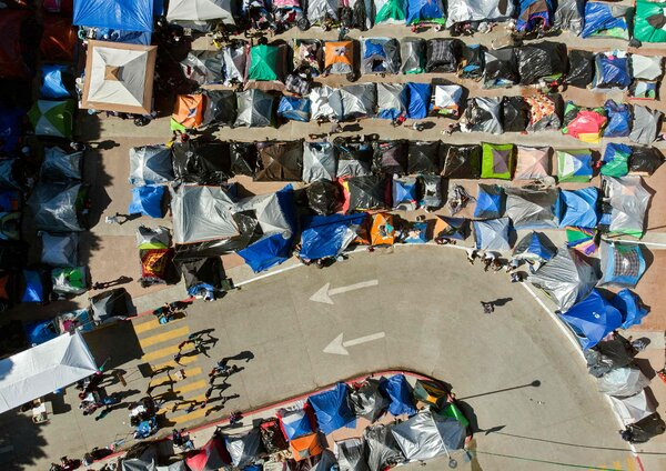A migrant camp outside Tijuana, in Baja California.The practice of expelling unaccompanied children ended because of a court ruling before President Biden took office.