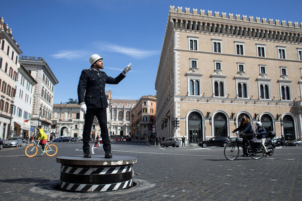 Pierluigi Marchionne, a veteran police officer in Rome, directing the light traffic last week in the ordinarily jammed Piazza Venezia.
