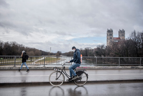 A cyclist in Munich crosses a bridge. The number of coronavirus cases in Germany is rising, prompting the government to extend lockdown measures.